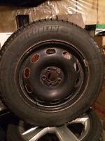 15-inch 5x100 steel rims and Michelin X-Ice Xi3 195/65-15
