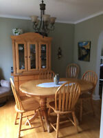 Double pedestal solid oak table with 6 chairs and buffet hutch
