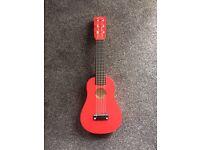 Child's guitar - John Lewis