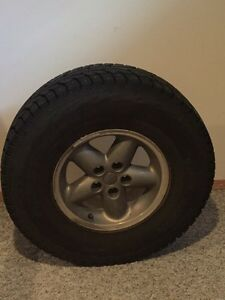 Hankooks studded on jeep rims .used only 1 month Prince George British Columbia image 2