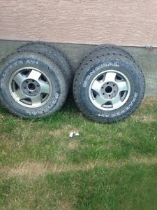 "Tires and 16"" 245-75-16 with Chev GMC rims"