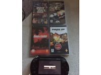 Black PSP for sale with 4 games