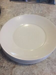 Five large white serving plates