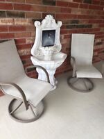Outdoor Swivelling Chairs and Decorative Fountain