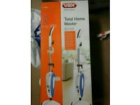 Boxed and never used Vax Total Home Master