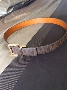 Authentic Michael Kors belt size large.
