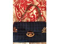 Patent blue handbag