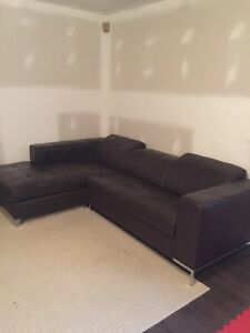 800$ Brown Leather couch Lshape with adjustable head rests