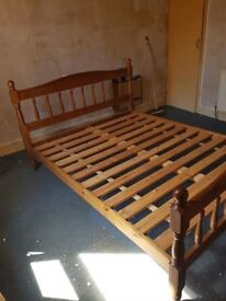 Queen sized bed. Wooden.
