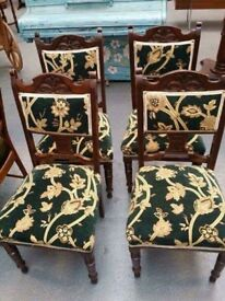 4 green upholstery chairs