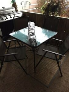 Brand new glass top patio set with umbrella