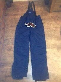 Men's Mountain Warehouse Ski/Snowboard Salopettes and Nevica goggles.