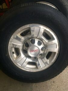 4 toyo snow tires  on gmc 2500 8 bolt rims