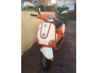 Orange and white Vespa et125