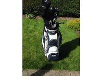 Left handed golf set. Clubs, bag, balls tees etc