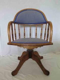 Antique oak swivel chair