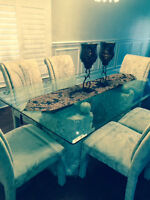 Glass dining table, stone base and 6 cloth parson chairs