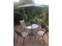Almost new outdoor garden table and chairs with parasol