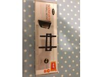 SEALED Ross Tv wall mount Supports 32-42 inch TVs