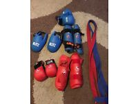 Red and blue sparring gear and belts. £20