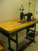 Antique Industrial Singer Sewing Machine With Button attachment.