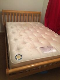 Wooden double bed frame with mattress