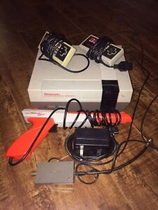 Nintendo (NES) with two controllers + 4 Mario games Kingston Kingston Area image 1