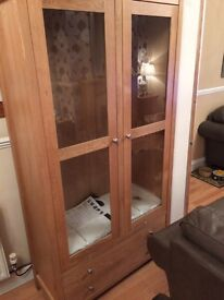 Glass fronted display cabinet.