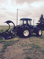 New Holland TV140 with Loader and Grapple