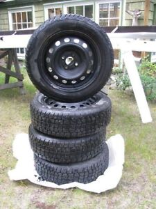 """Set of 4 new  15"""" Studed tires on rims"""