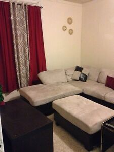 Sectional, ottoman, matching area rug, pillows