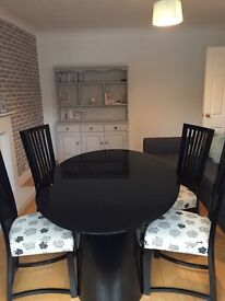 Black glass 'Casabella' Dining table and 4 chairs