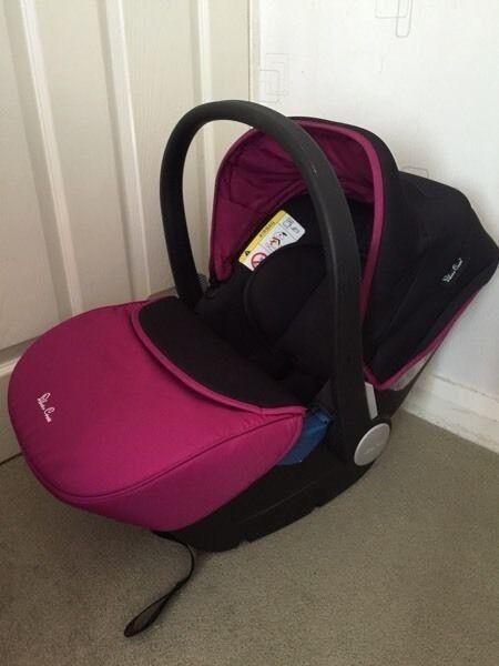 Pink silver cross car seat