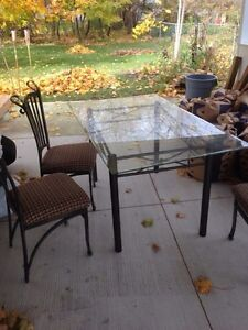 Glass table with 4 chairs London Ontario image 1