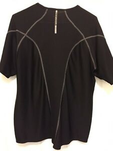 Two black Under Armor shirts. Practically new! London Ontario image 1