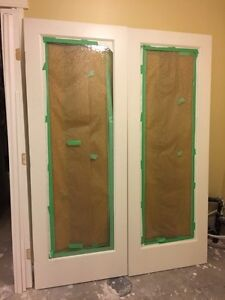 Brand new French glass door  sold wood with trims