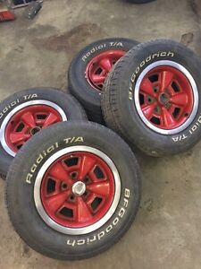"""Original Chevy rally 15"""" rims and tires"""