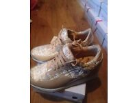 Job lot of 34 pairs ladies glitter trainers/shoes