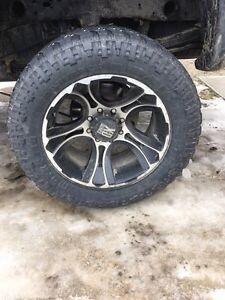 "KMC XD series 801 crank 22""x12"" wheels with 37""x13.50"" tires"