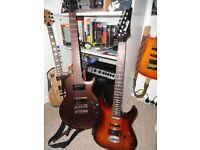 2 ibanez electric guitars