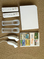 Nintendo Wii with 2 Controllers, 2 Nunchucks 1 Game and 2 Grips