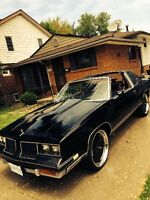 """$4,700 for a t top cutlass salon with a 350 motor and 22"""" DUBS"""