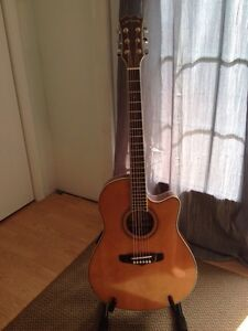 Acoustic electric guitar with gig bag