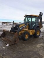 Backhoe and excavator services in central alberta.