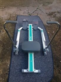 Delta rowing exercise machine