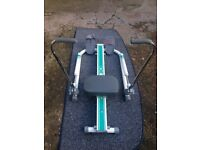 Delta rowing exercise machine