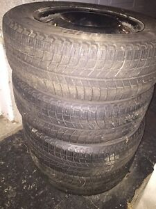 Snow tires and rims together for sale - used one season