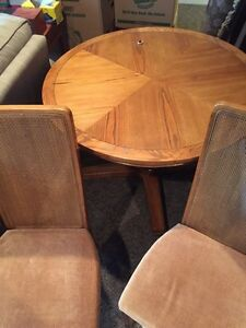 Oak table with 4 chairs , plus Hutch