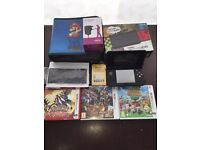 New Nintendo 3ds, with 3 games , U.K. Charger and carry case