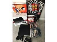 PS3 with lots of games and accessories